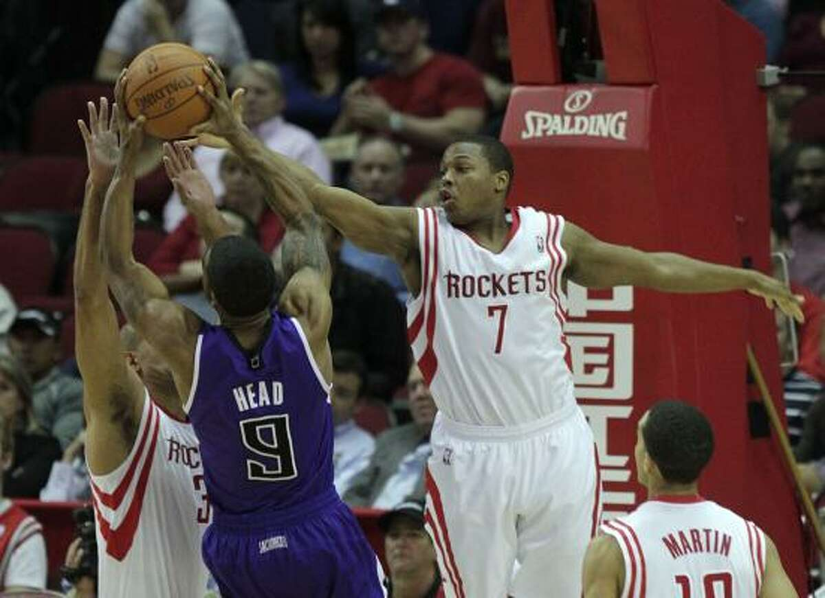 Rockets point guard Kyle Lowry (7) and Rockets small forward Shane Battier defend Kings shooting guard Luther Head (9) as he puts up a shot in the second quarter.