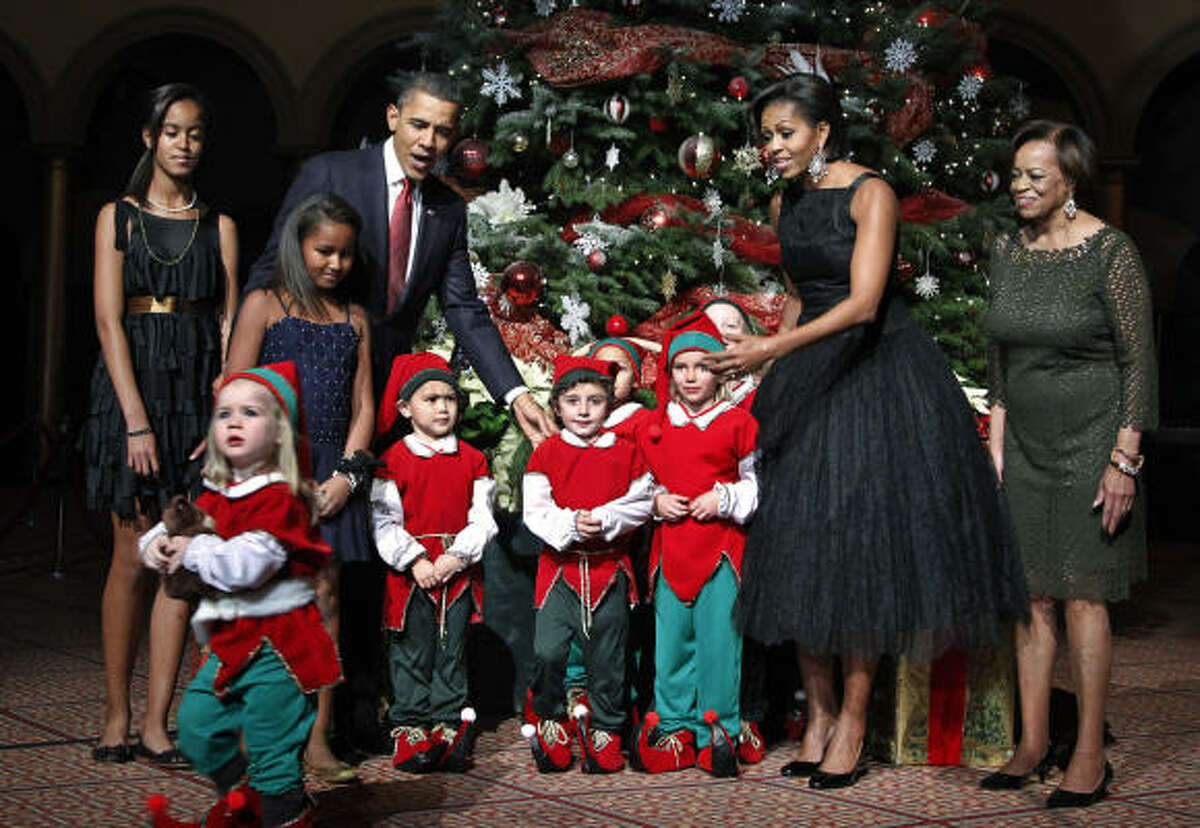The first family-- Malia Obama, Sasha Obama, President Barack Obama, first lady Michelle Obama, and the first lady's mother Marian Robinson-- wore their holiday best for the annual