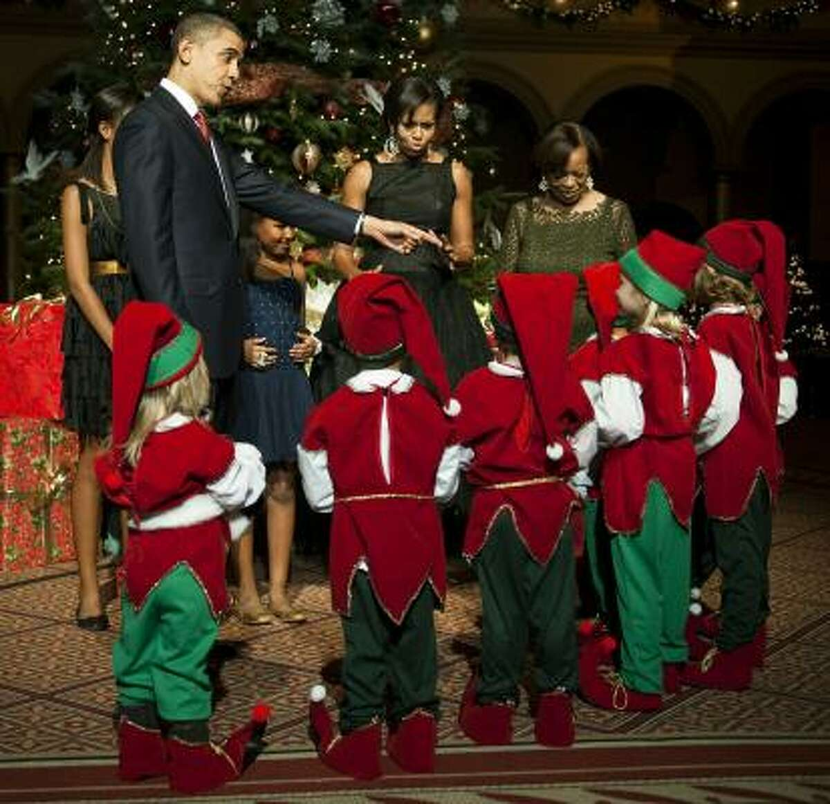 Obama instructs the elves about labor laws and U.S. relations with the North Pole.