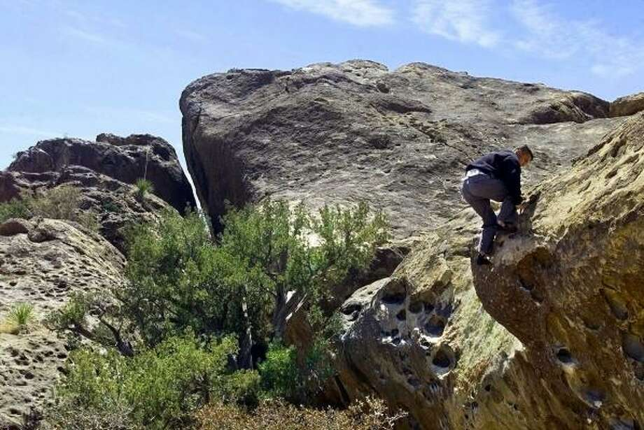 Hueco Tanks State Park near El Paso attracts many people interested in rock climbing. Photo: DAVID KENNEDY, ASSOCIATED PRESS