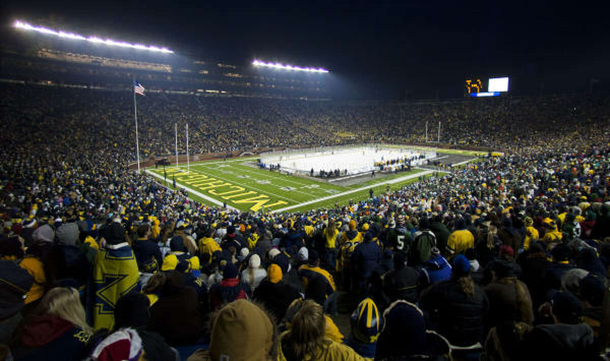 A world record 113,411 watched Michigan blank Michigan State 5-0 at the 'Big Chill' at the Big House NCAA college hockey game, at Michigan Stadium in Ann Arbor, Mich., on Saturday, Dec. 11, 2010.