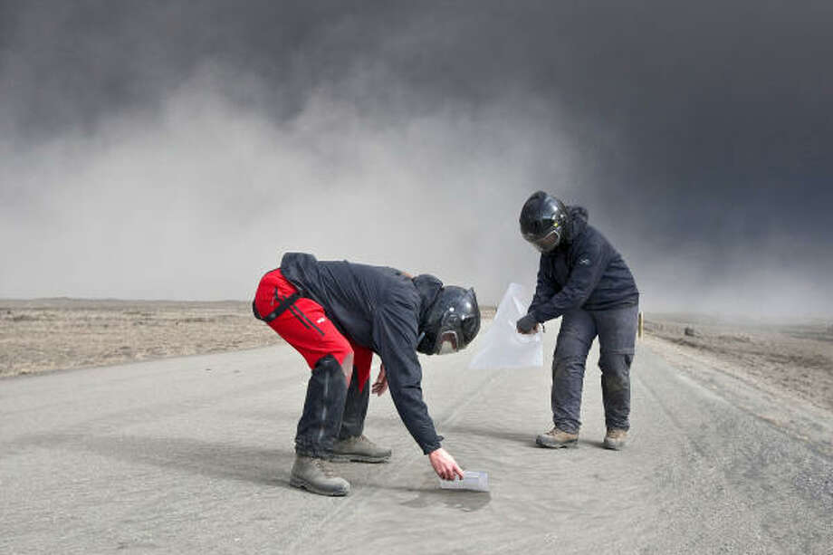 Scientists collect ash from Eyjafjallajökull volcano, whose eruption's effects are felt worldwide. Photo: OMAR OSKARSSON, AFP/Getty Images