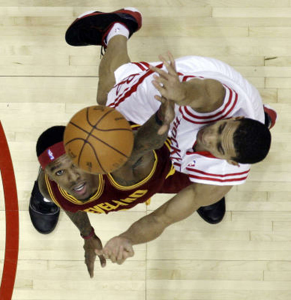 Rockets guard Kevin Martin, right, shoots over Cleveland Cavaliers guard Daniel Gibson during the first quarter.