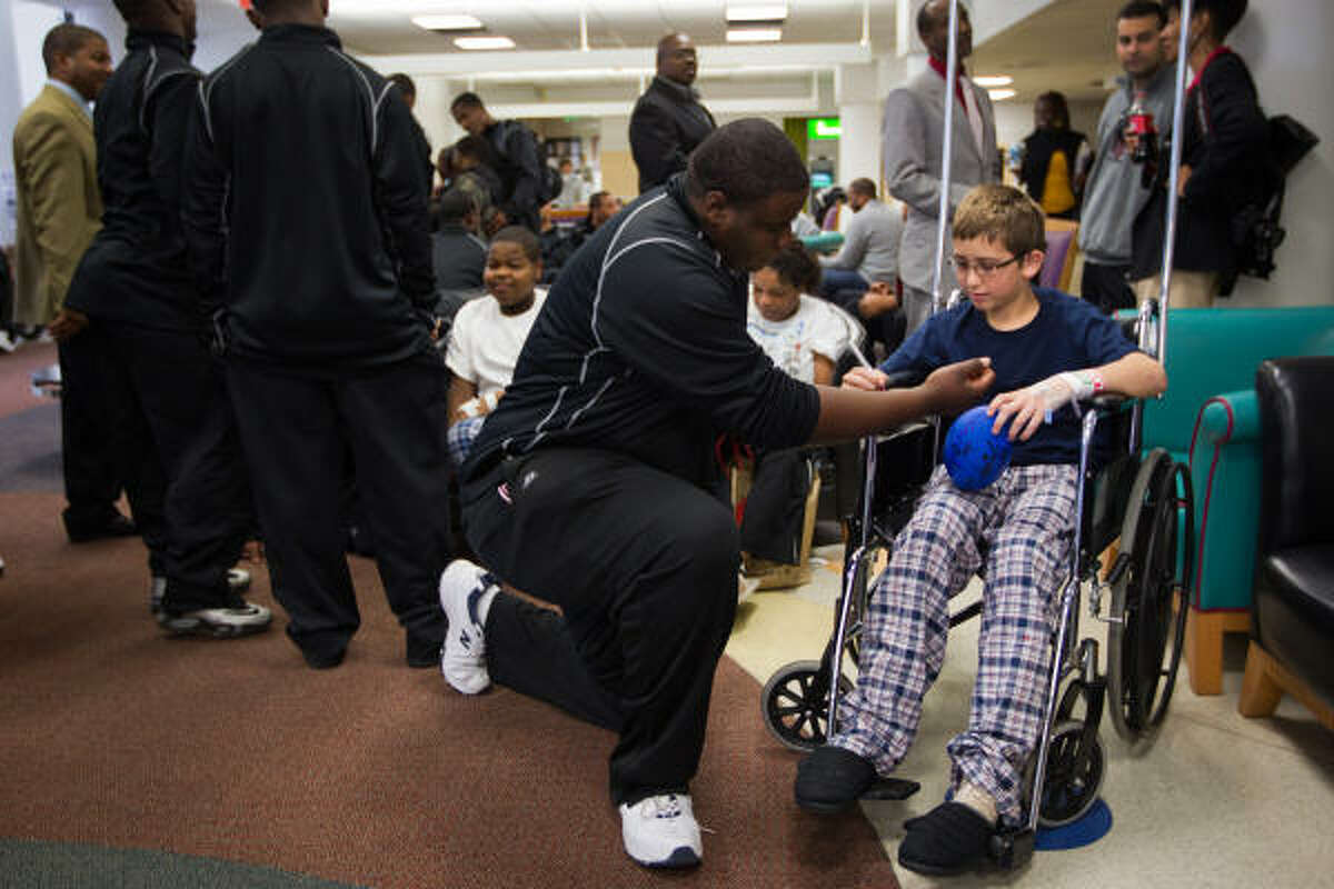 Texas Southern Tigers offensive linesman Kenneth Hall has his forearm autographed by Dalton Ainsworth, 11, during a visit to Children's Hospital of Alabama in Birmingham, Ala.
