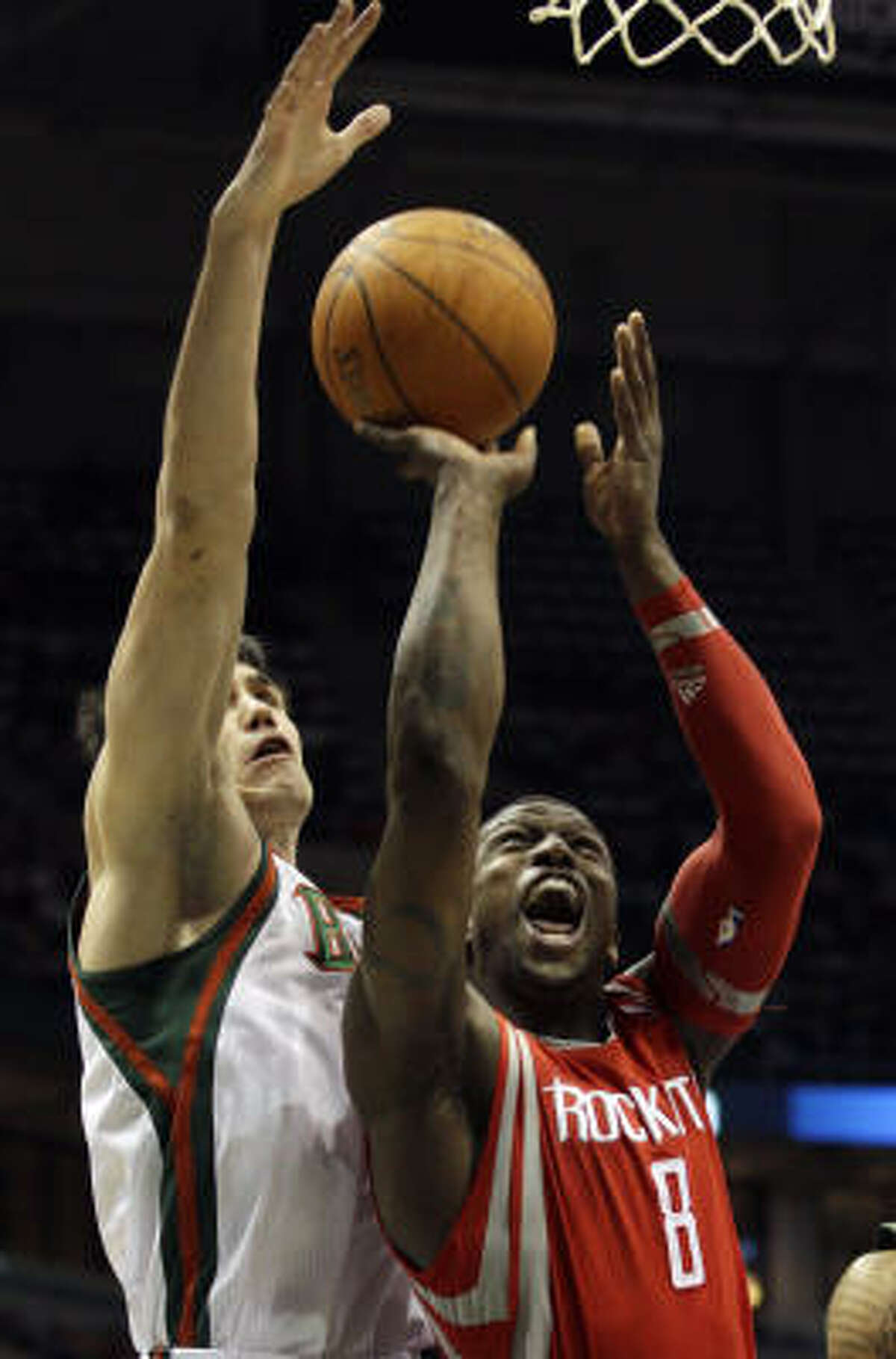 Rockets guard Jermaine Taylor (8) tries to shoot in front of Bucks forward Ersan Ilyasova during the first half.