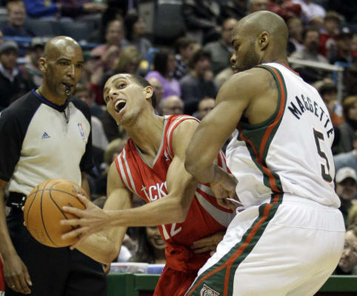 Rockets guard Kevin Martin, left, is fouled by Bucks forward Corey Maggette during the first half.