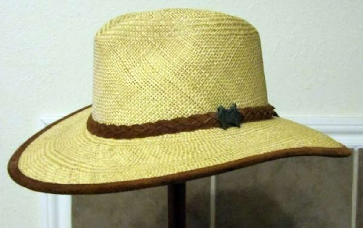 Australian Outback straw hat. Straw is a comfortable option in warm climates, especially at golf courses. A good straw hat bends but does not easily break.