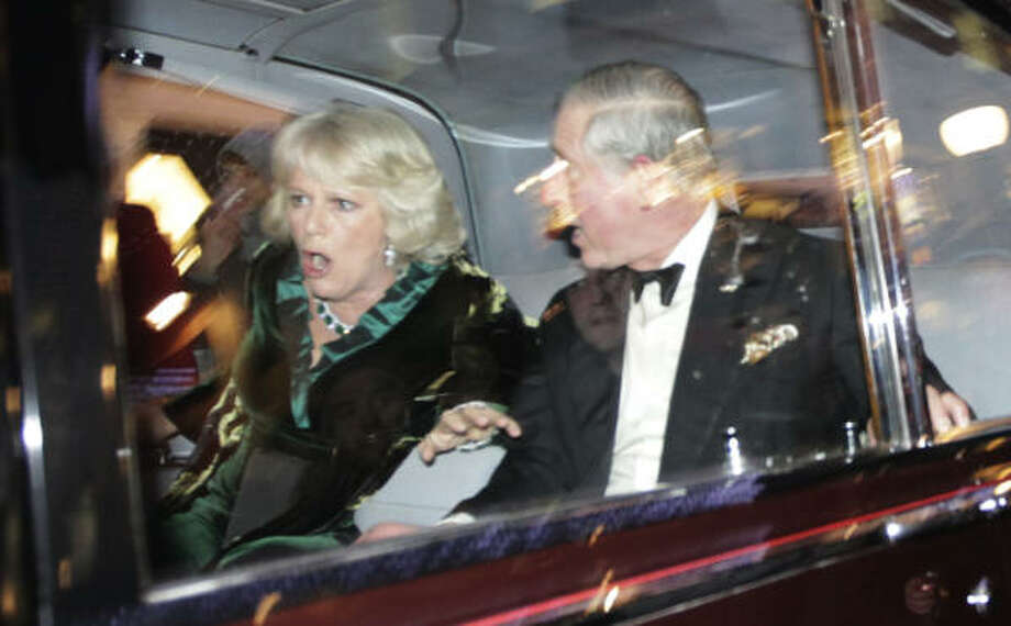 Britain's Prince Charles and Camilla, Duchess of Cornwall, react as their car is attacked, in London, Thursday, Dec. 9, 2010. Angry protesters in London attacked the prince's car in Regent Street, in the heart of London's shopping district. The car then sped off. Photo: Matt Dunham, AP