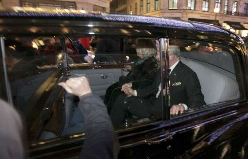 Britain's Prince Charles and Camilla, Duchess of Cornwall, react as their car is attacked, in London, Thursday, Dec. 9, 2010. Angry protesters in London attacked the prince's car in Regent Street, in the heart of London's shopping district. The car then sped off.