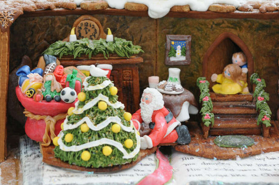 "Kim Knebel's ""Twas the Night Before Christmas"" gingerbread house features Santa delivering presents. Photo: Heidi Murrin, AP"
