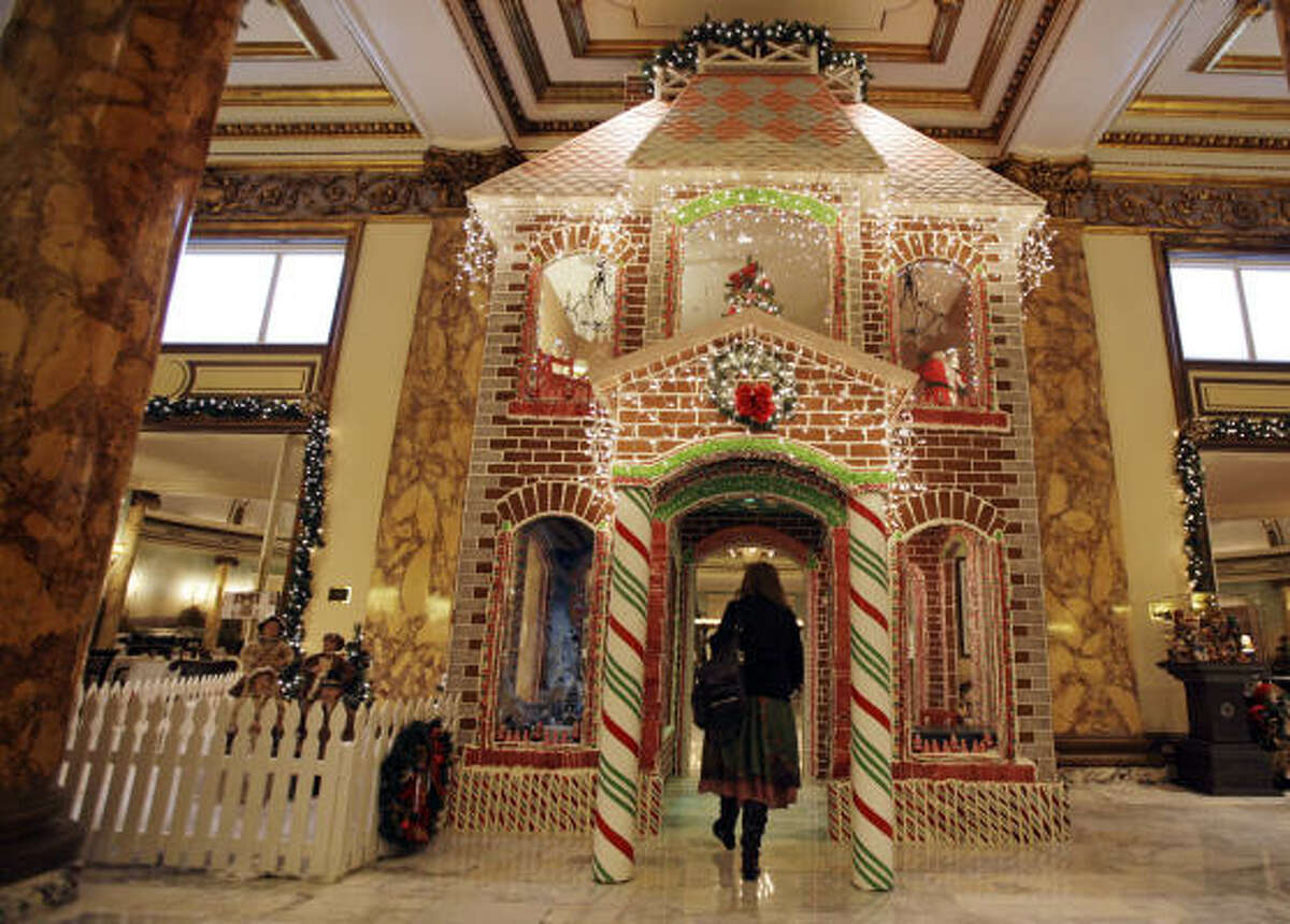 The gingerbread house in the lobby of the Fairmont Hotel in San Francisco was made with 5500 pieces of gingerbread, 850 pounds of icing, 425 pounds of candy and eight gallons of chocolate.
