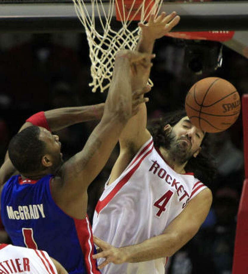 Pistons guard Tracy McGrady (1) goes up for a shot with Rockets power forward Luis Scola defending during the first half. Photo: Brett Coomer, Chronicle