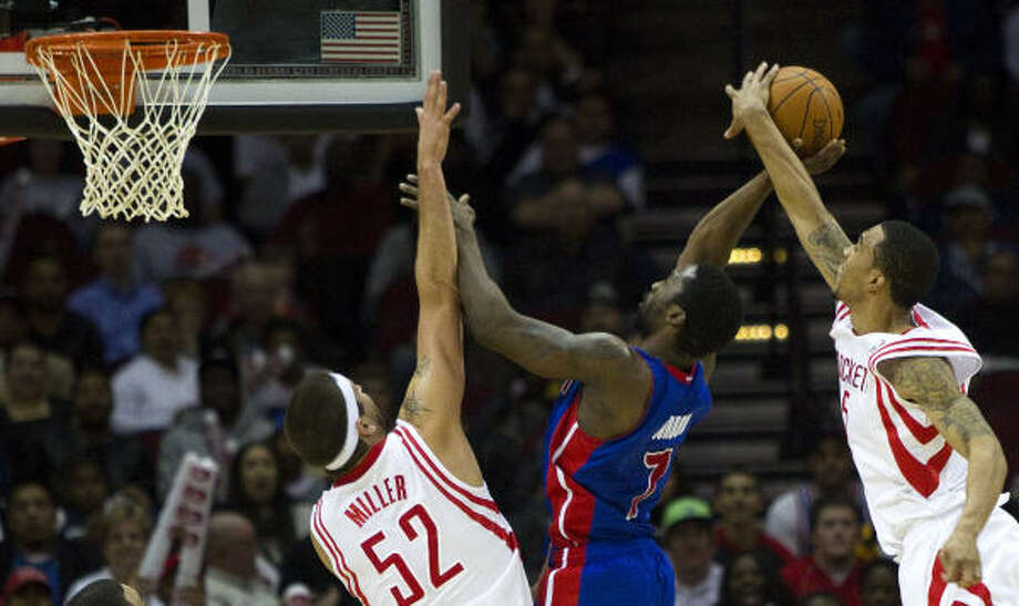 Rockets guard Courtney Lee blocks a shot by Pistons guard Ben Gordon with Rockets center Brad Miller (52) in on the play during the second half. Photo: Brett Coomer, Chronicle