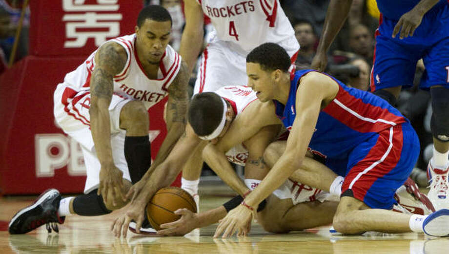 Rockets guard Courtney Lee, left, Rockets center Brad Miller and Pistons small forward Austin Daye go to the floor for a loose ball during the second half. Photo: Brett Coomer, Chronicle