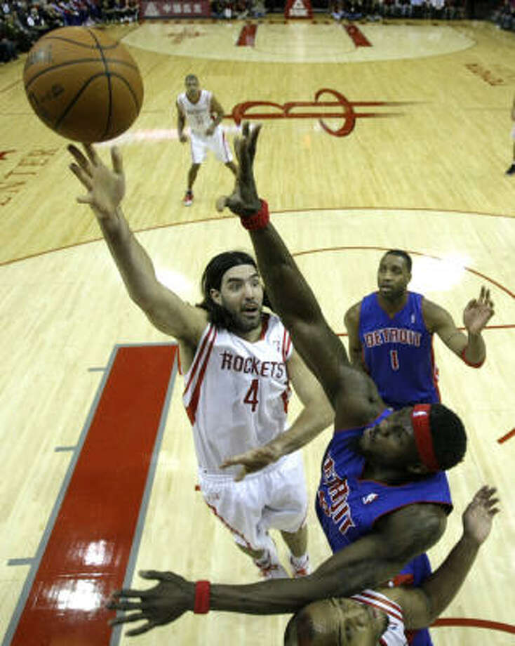 Rockets power forward Luis Scola goes up for a shot over Pistons center Ben Wallace during the first half. Photo: Brett Coomer, Chronicle