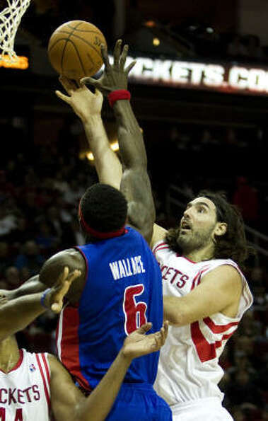 Rockets power forward Luis Scola goes up for a shot against Pistons center Ben Wallace during the fi