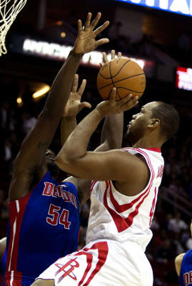 Rockets center Chuck Hayes goes up for a shot against Pistons power forward Jason Maxiell during the first half. Photo: Brett Coomer, Chronicle