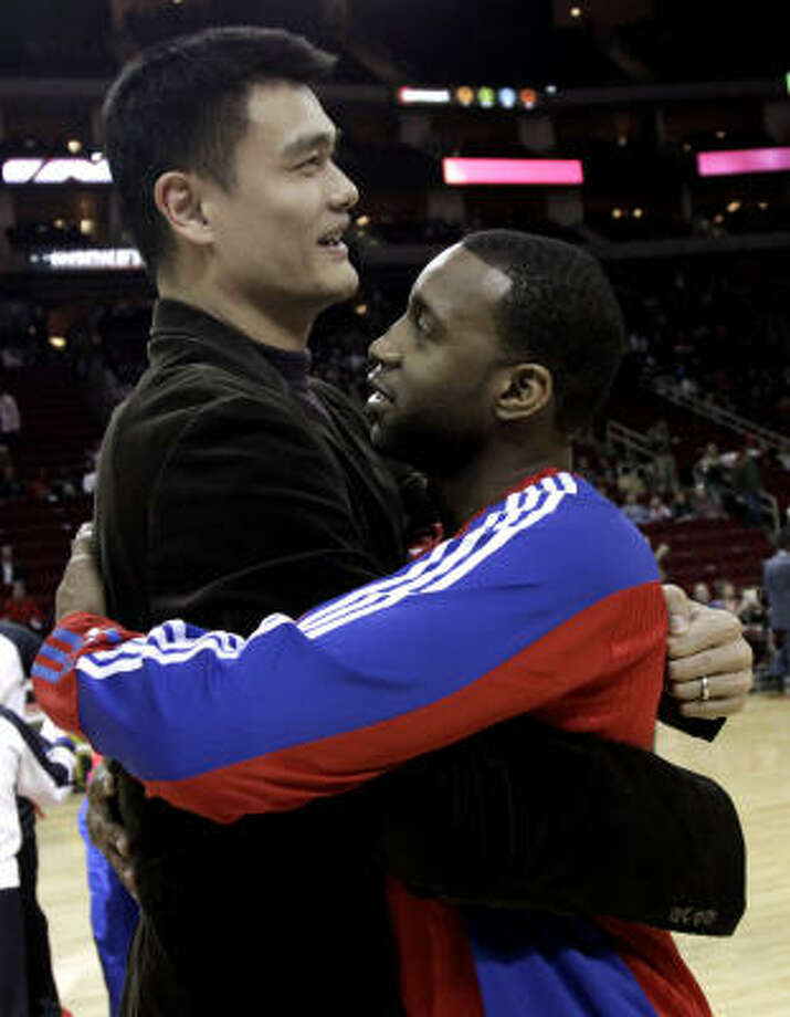 Former teammates Rockets center Yao Ming, left, and Pistons guard Tracy McGrady, right, hug before the game. Photo: David J. Phillip, AP
