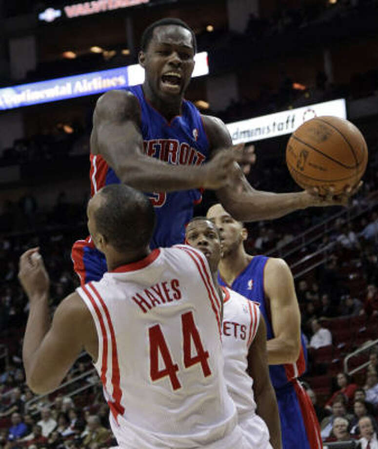 Pistons guard Rodney Stuckey collides with Rockets center Chuck Hayes during the first quarter. Photo: David J. Phillip, AP