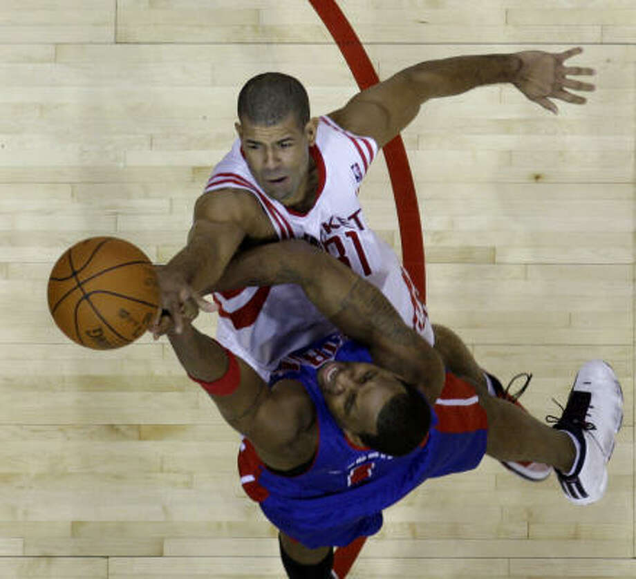Pistons guard Tracy McGrady goes up for a shot as Rockets forward Shane Battier defends during the third quarter. Photo: David J. Phillip, AP