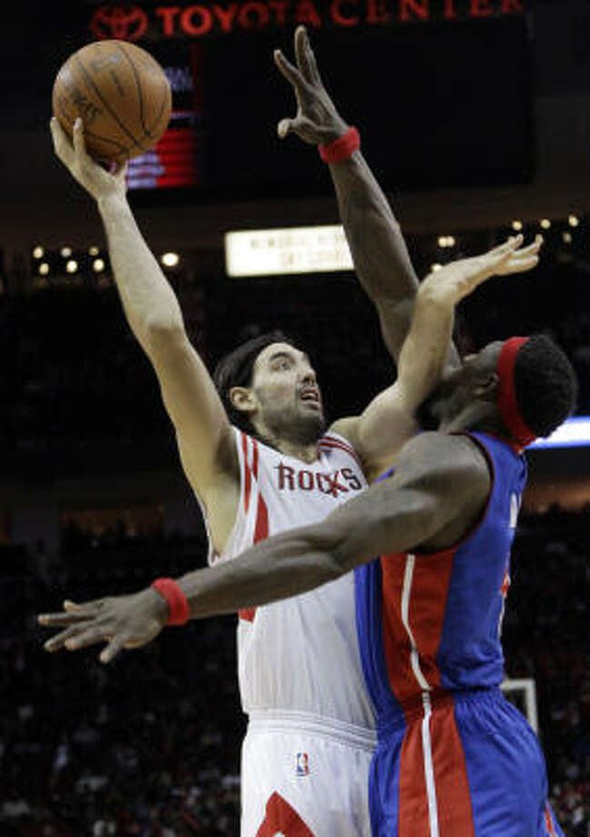 Rockets forward Luis Scola, left, shoots over Pistons  center Ben Wallace, right, during the third quarter. Photo: David J. Phillip, AP