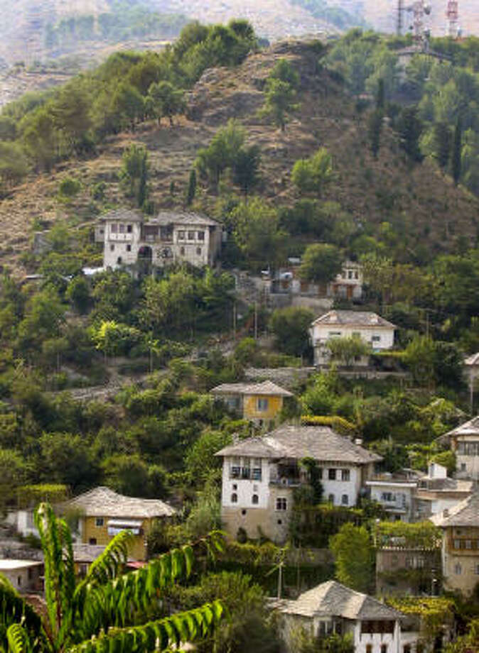 "A view of the so-called ""fortress houses"" on the town's steep slopes. Photo: JIM HEINTZ, AP"