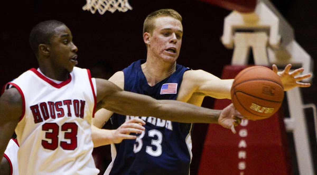 Houston guard Trumaine Johnson (33) knocks the ball away from Nevada forward Kevin Panzer (33) for a turnover.