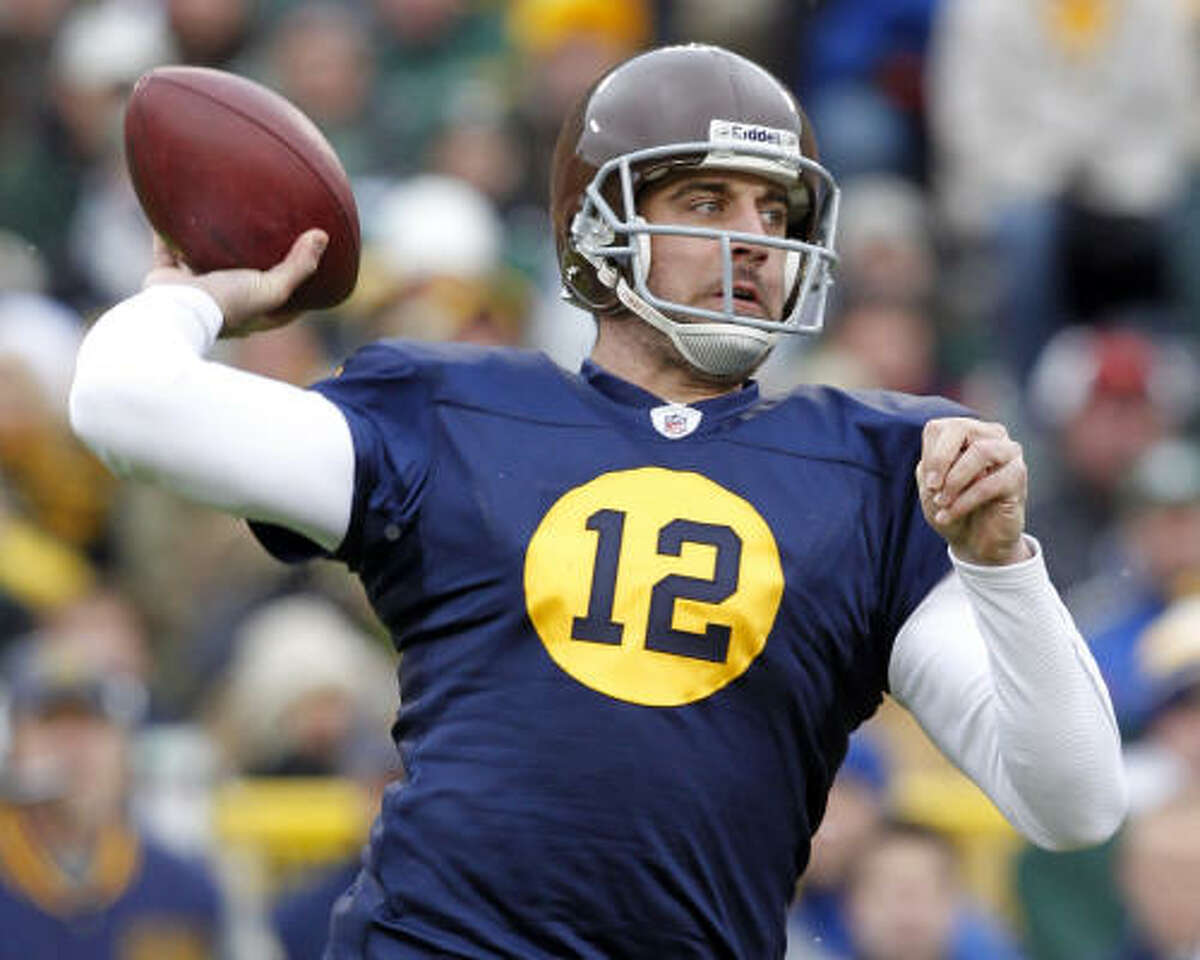 Packers 34, 49ers 16 Packers quarterback Aaron Rodgers, wearing the Packers' throwback jersey, threw for three touchdowns against the 49ers.