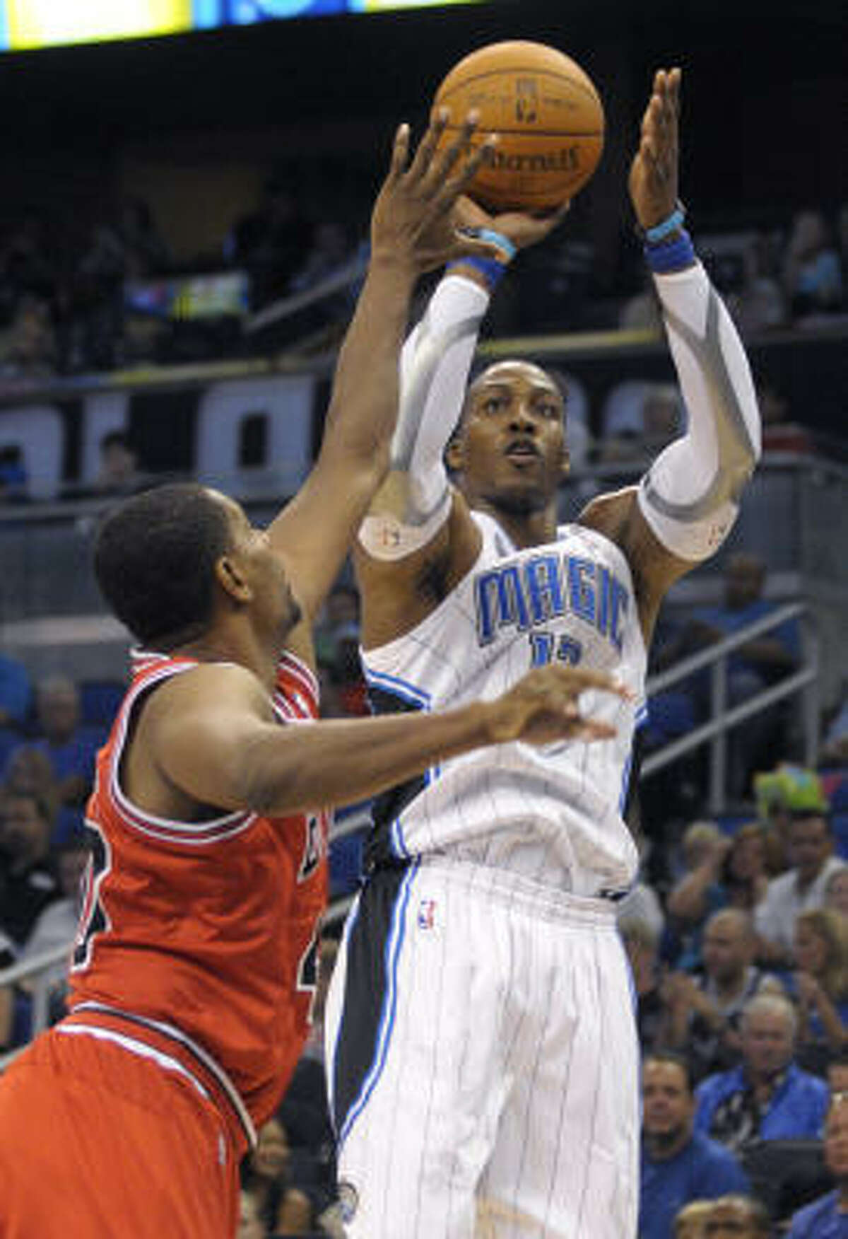 NO. 3 ORLANDO MAGIC With Dwight Howard, open shots for teammates and another top-five defense seem like certainties, not to mention the team falling short of a title if the league's top center can't become less predictable offensively.