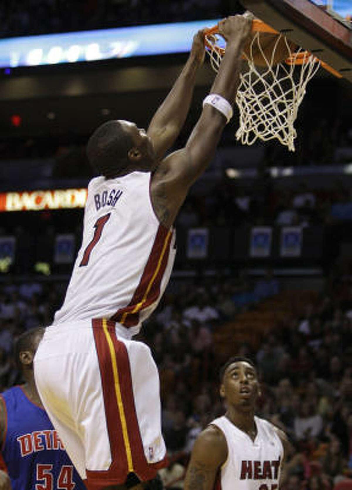 Heat power forward Chris Bosh dunks during the second quarter.