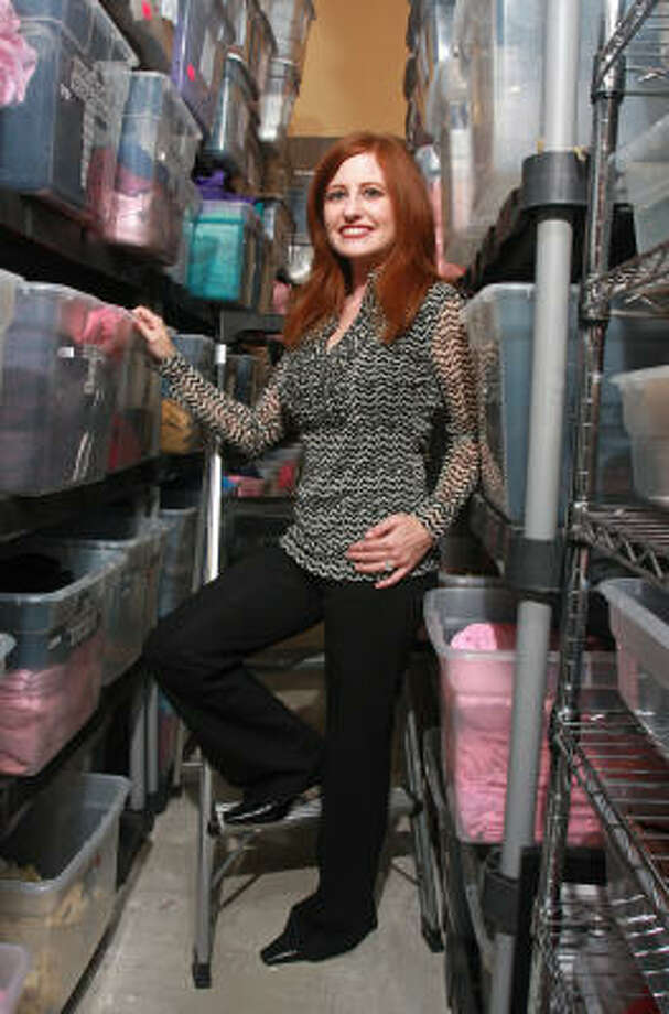 Danielle Yates, owner of Headcovers Unlimited, says the firm keeps to the mission that was started by her late mother. Photo: Gary Fountain, For The Chronicle