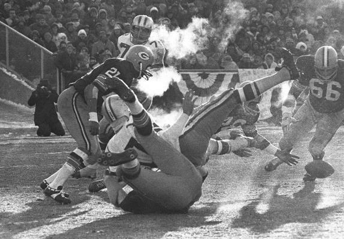 Meredith, who was a Cowboys quarterback from 1960-68, fumbles against the Packers on Dec. 31, 1967, during the championship game, which has been dubbed the