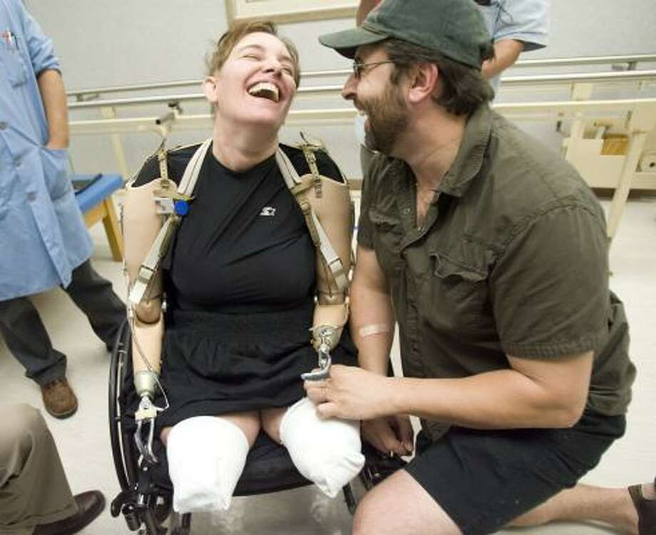 Katy Hayes smiles big with her husband, Al, after receiving prosthetic arms at Muilenburg Prosthetics in Houston. MCP_PLUCK=0 Photo: Billy Smith II, Houston Chronicle