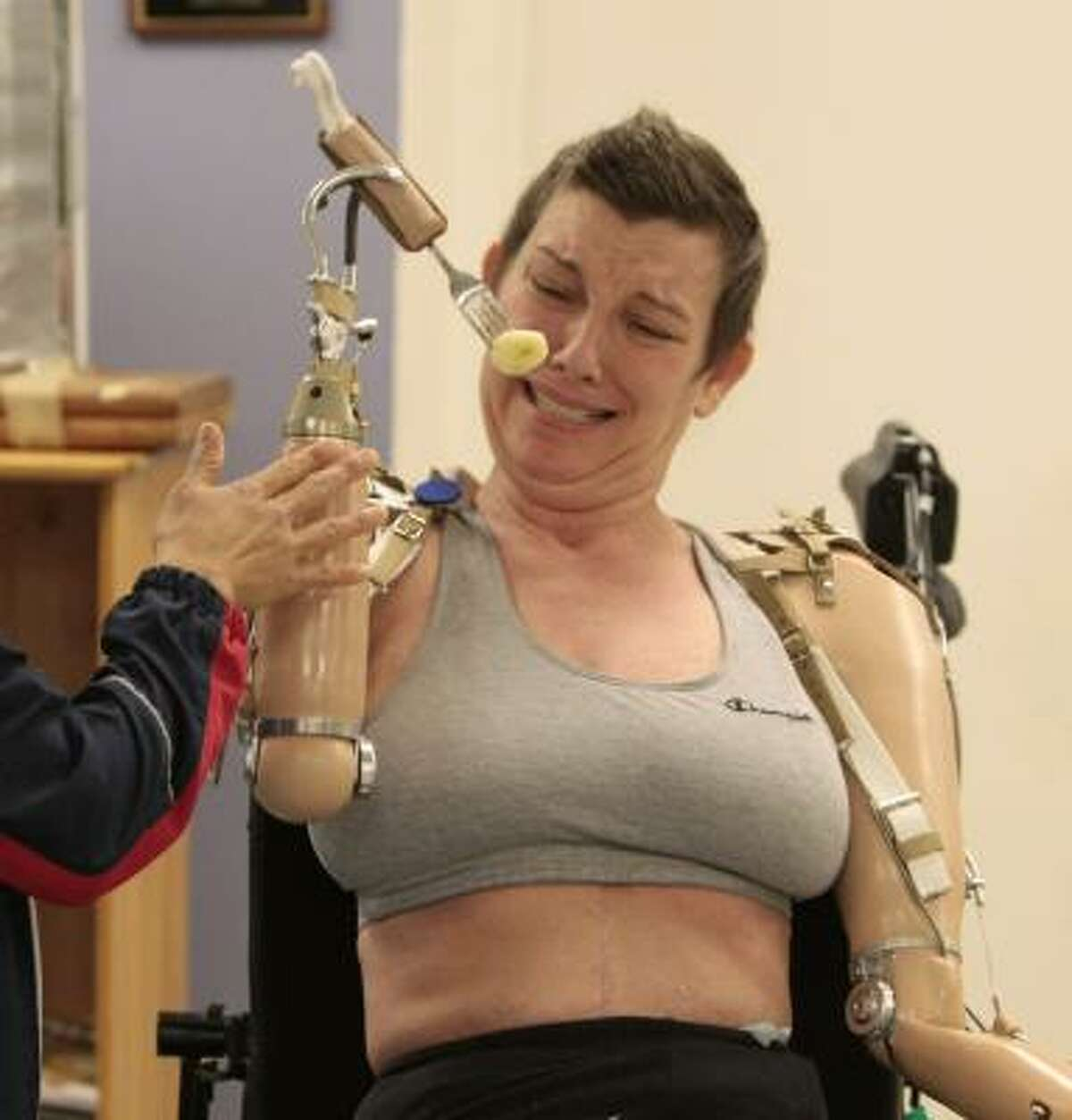 Hayes struggles to adjust to her prosthetic arms at Memorial Hermann's Institute for Rehabilitation and Research.