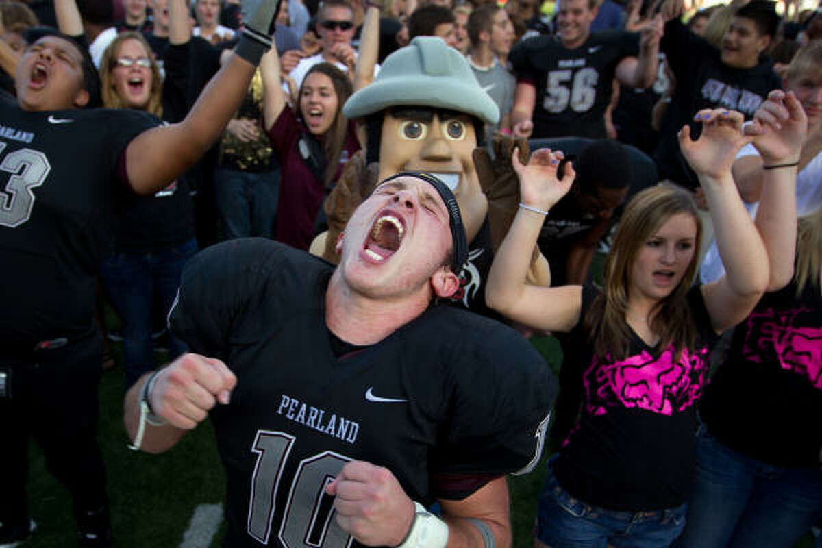 Pearland wide receiver Myles Kanipes (10) celebrates after the Oilers' victory.
