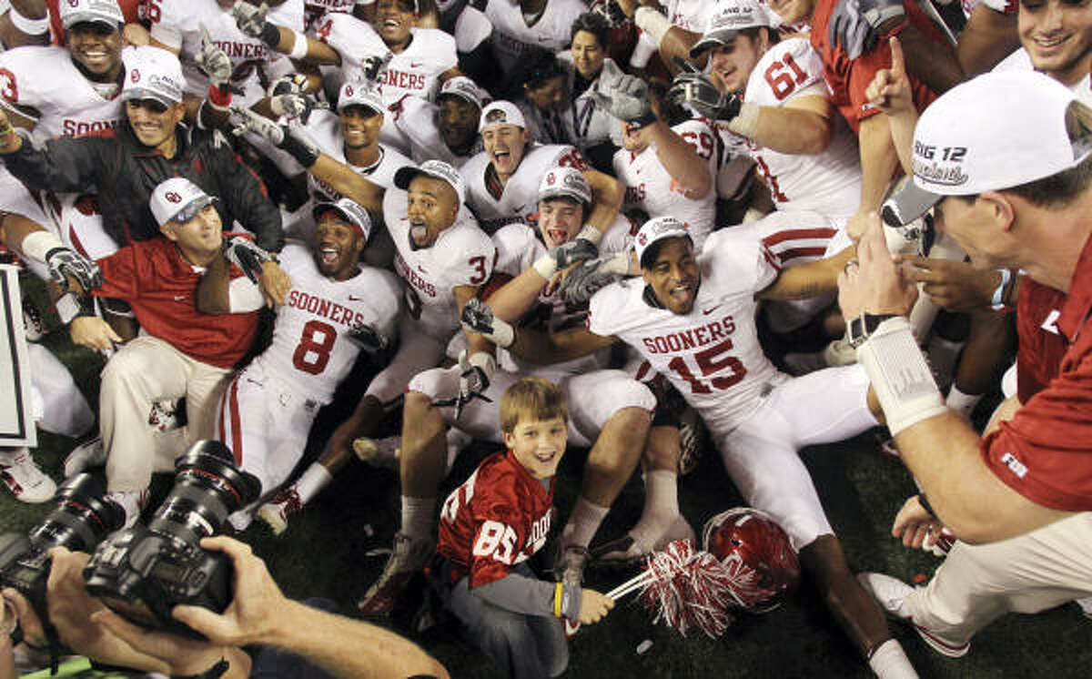 Dec. 4: Oklahoma 23, Nebraska 20 The Oklahoma Sooners celebrate after beating Nebraska in the Big 12 championship game Saturday in Arlington.