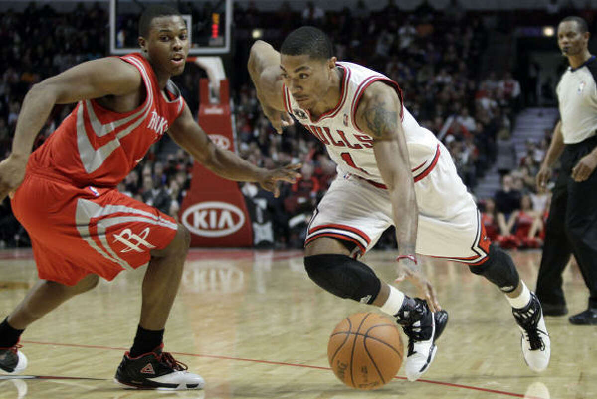 Bulls guard Derrick Rose, right, drives to the basket against Rockets guard Kyle Lowry during the fourth quarter. Rose scored a game-high 30 points, dished out 11 assists, pulled down seven rebounds and had five steals to lead Chicago.