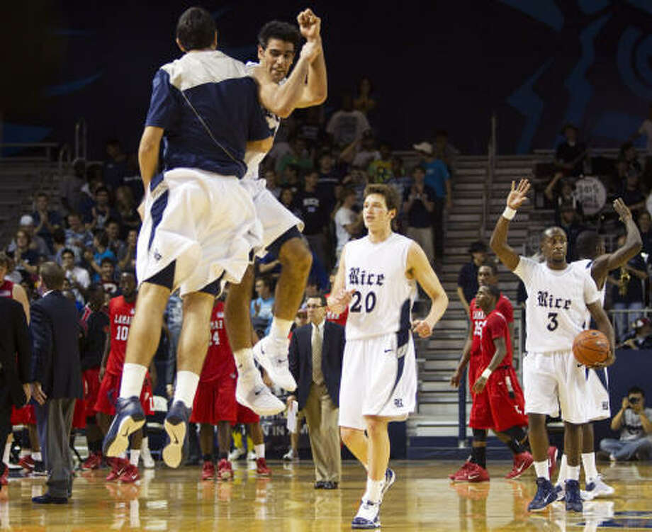 Dec. 4: Rice 75, Lamar 73 Rice forward Arsalan Kazemi, center, leaps in the air with a teammate while celebrating their win over Lamar on Saturday at Tudor Fieldhouse. Kazemi led all scorers with a career-high 24 points. Photo: Brett Coomer, Chronicle