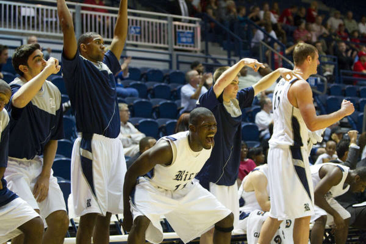 The Rice bench erupts after a teammate hits a 3-pointer during the second half.