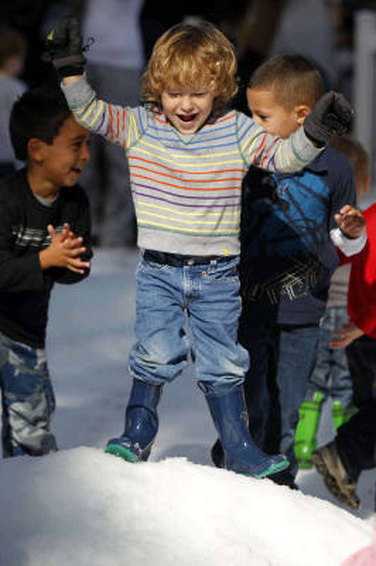 Eli Saldana, 3, of Houston, plays during the Annual Snow Flurry at the Houston Museum of Natural Science.