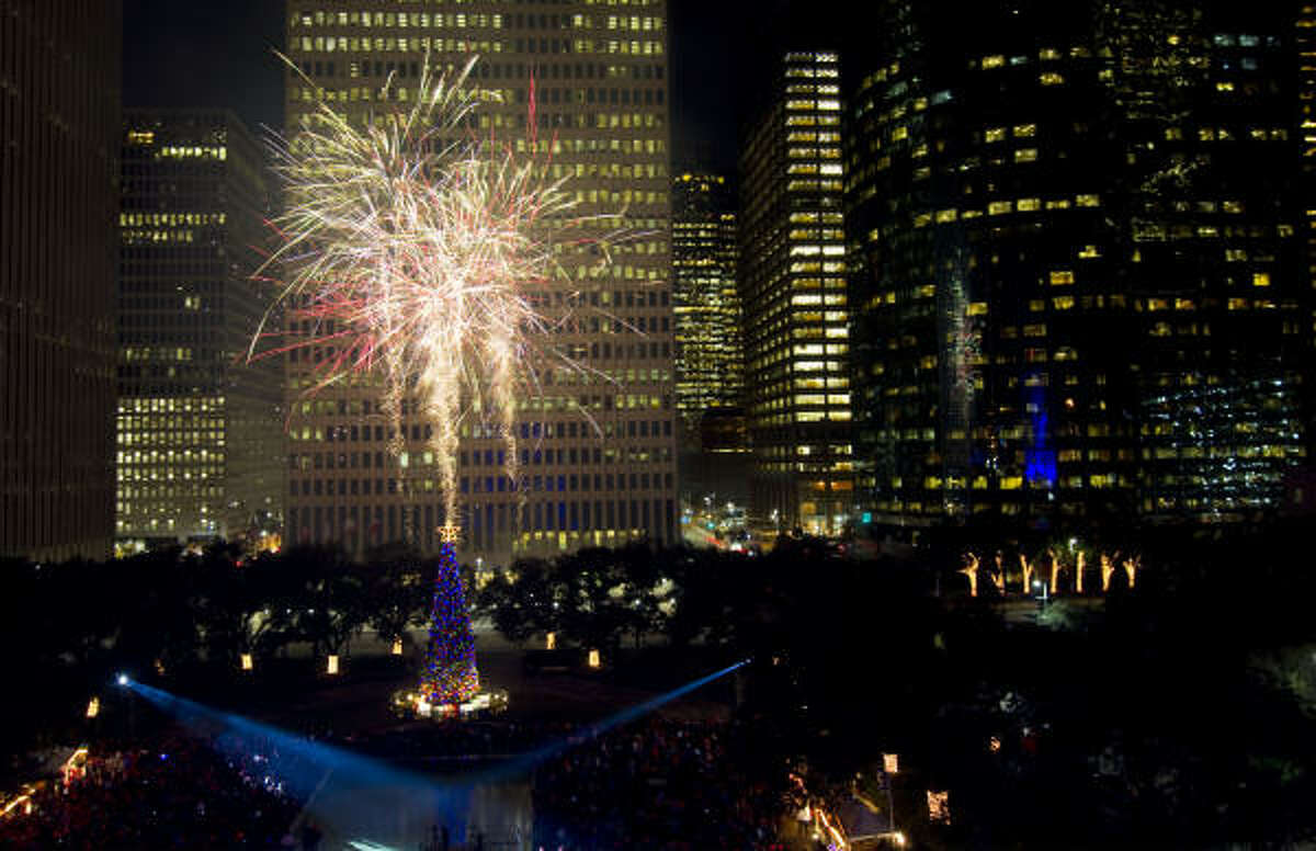 Fireworks go off above Houston's newly lit Christmas tree during the Mayor's Holiday Celebration outside City Hall.