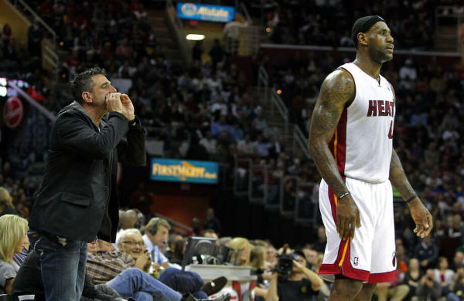 A fan, left, heckles Miami Heat's LeBron James. Photo: PHIL MASTURZO, MCT