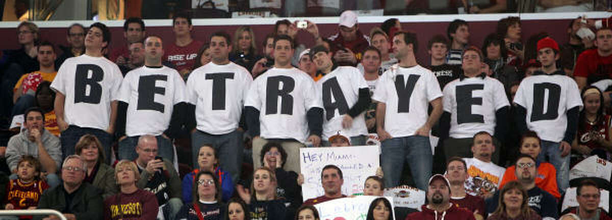 Cavaliers fans wear their feelings on their shirts at a home game. The game marks the first time LeBron James, the former local franchise player, has played in Cleveland since he jumped to the Heat as a free agent.