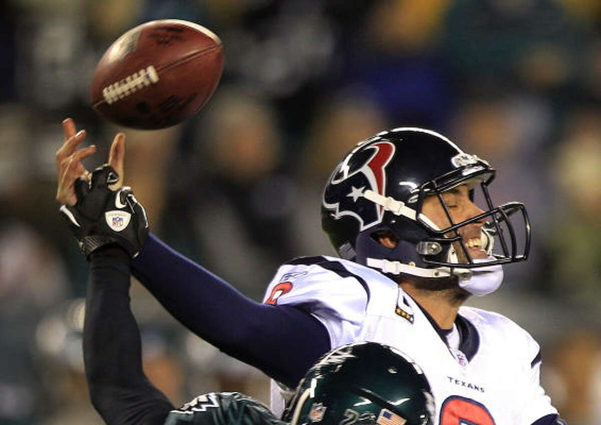 Houston Texans quarterback Matt Schaub (8) has his arm hit by Philadelphia Eagles safety Quintin Mikell (27) for an incomplete pass during the second quarter.