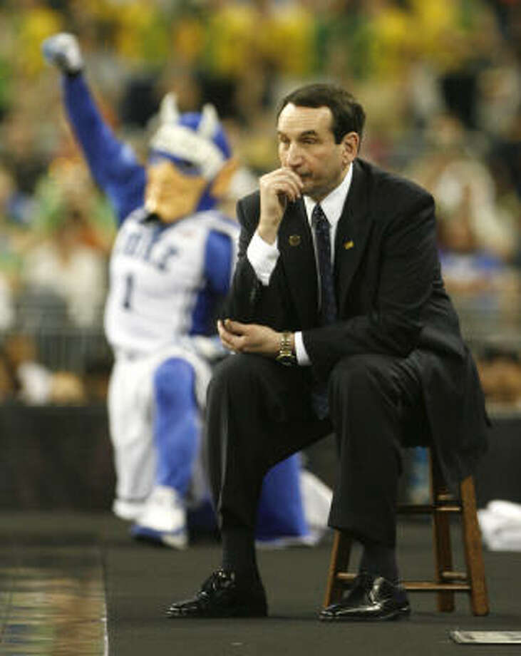 Duke head coach Mike Krzyzewski watches his team against Baylor from a stool on the elevated floor. Photo: James Nielsen, Chronicle