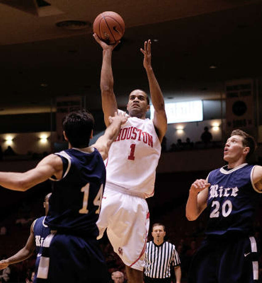 Houston's Sean Coleman shoots over Rice's Arsalan Kazemi. Coleman had a career-high 12 points in his final regular-season home game. Photo: Bob Levey, For The Chronicle