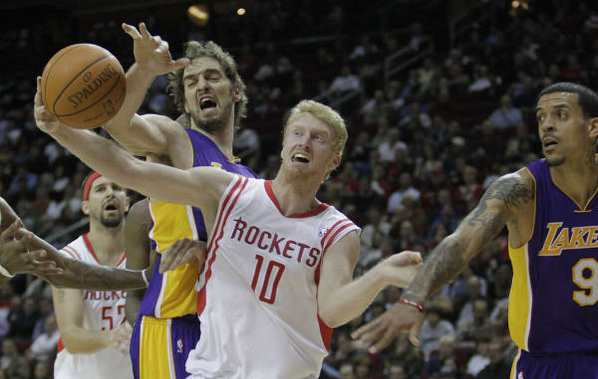 Rockets forward Chase Budinger (10) battles with Lakers forwards Pau Gasol, left, and Matt Barnes for a ball in the second half.