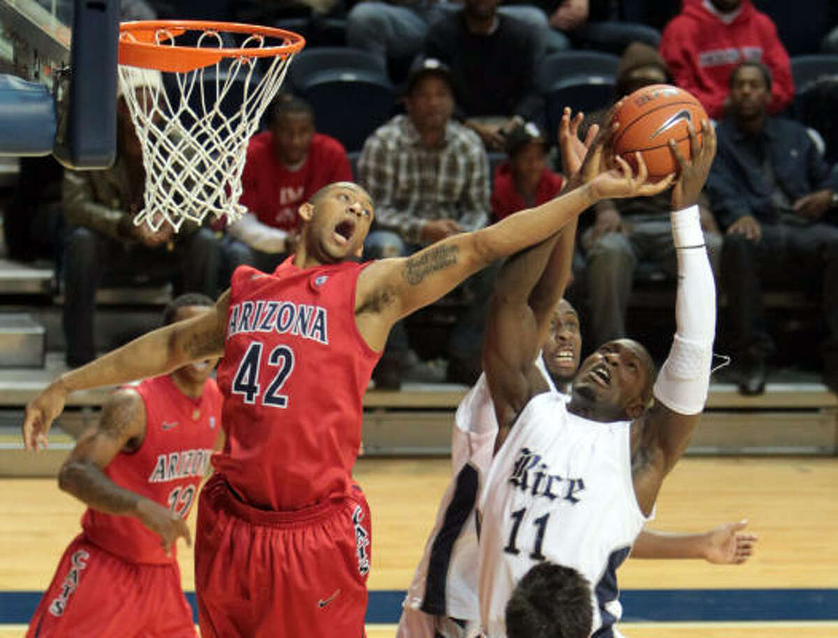 Rice forward Suleiman Braimoh (11) out-jumps Arizona forward Jamelle Horne (42) for a rebound in the second half of Wednesday's matchup at Tudor Fieldhouse. Rice fell 84-57.
