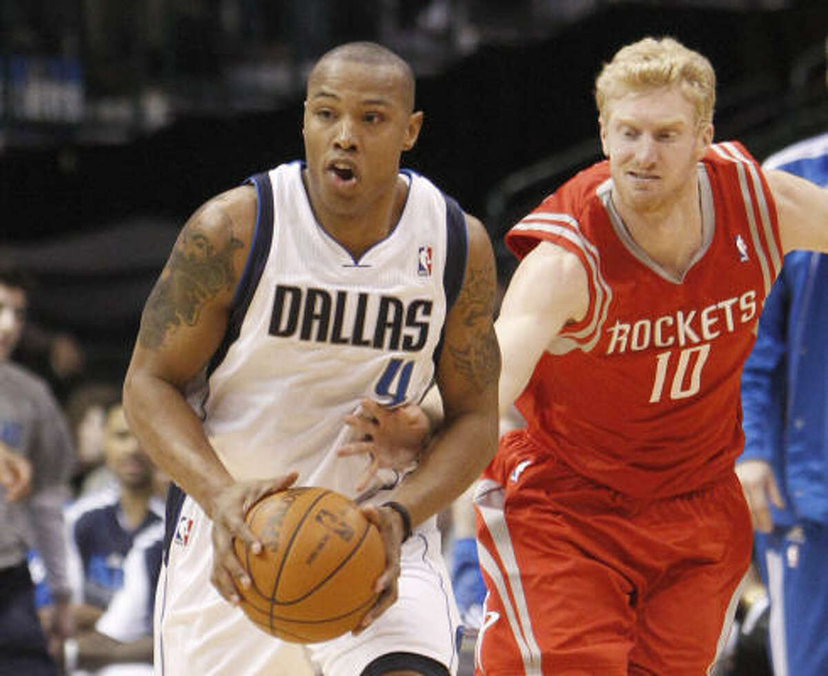 Mavericks small forward Caron Butler (4) brings the ball up court after the steal against Rockets forward Chase Budinger (10).