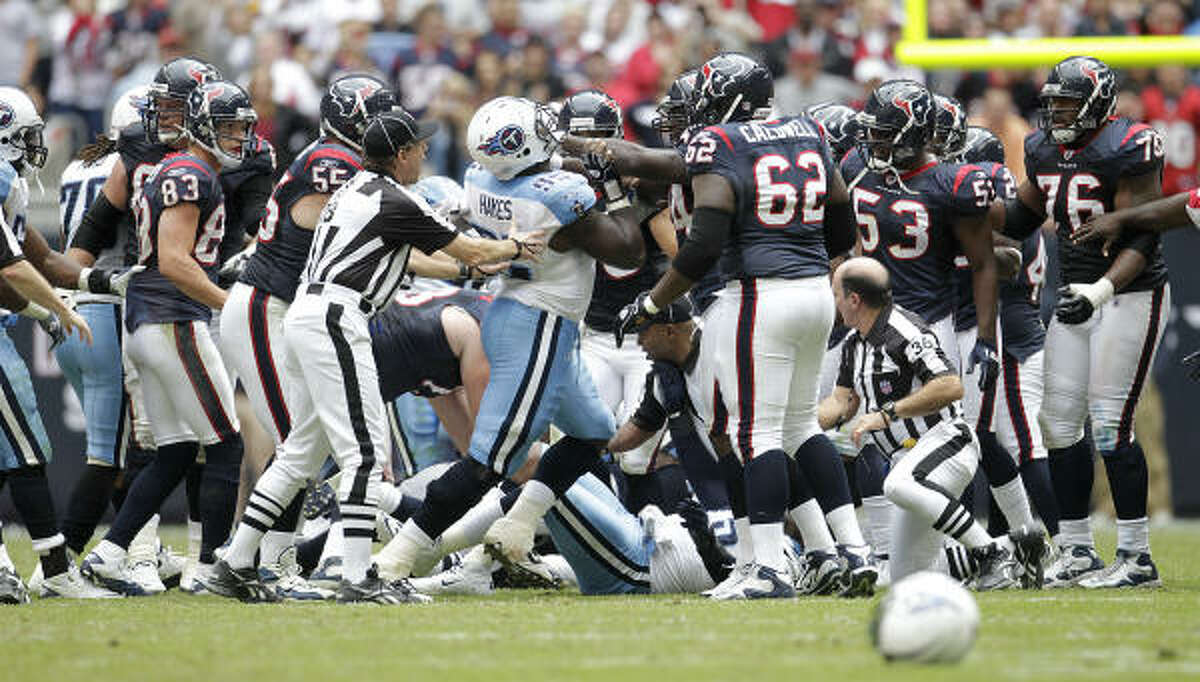 Texans and Titans players get into a scrum after Texans wide receiver Andre Johnson got into a fist fight with Titans cornerback Cortland Finnegan midway through the fourth quarter. Both Johnson and Finnegan were ejected from the game.